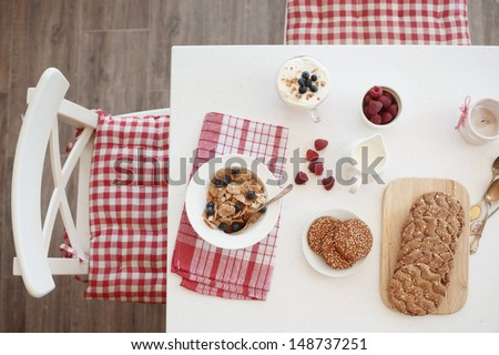 Breakfast with summer berries and cereal bread top view - stock photo