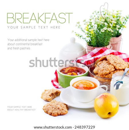 Breakfast with tea and fresh cookies. Isolated on white background - stock photo
