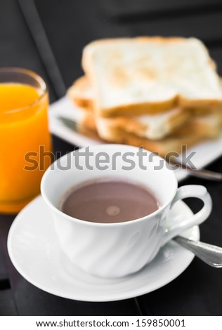 Breakfast with toast, coffee and orange juice