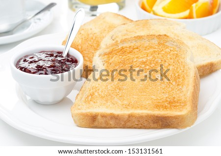 breakfast with toasts, jam, coffee and orange juice, horizontal closeup