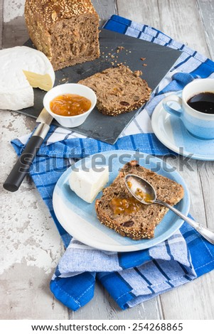 Breakfast with whole grain bread with dry fruit - stock photo