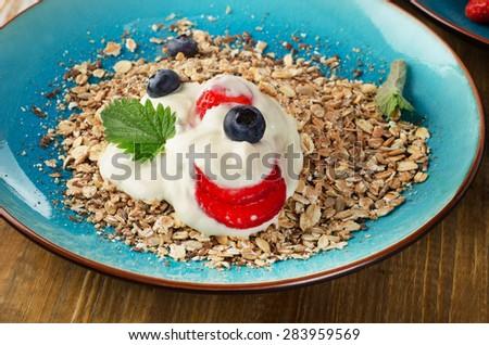 Breakfast with  yogurt and muesli. Selective focus - stock photo