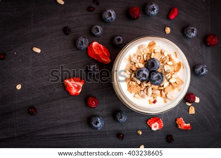Breakfast with yogurt, muesli and fruits. Fresh yogurt. Healthy food concept. Top view, flat lay