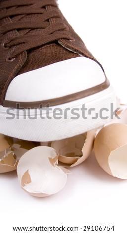 Breaking eggshells  by walking on them - stock photo