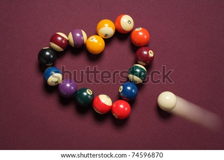 breaking heart concept using billiard balls - stock photo