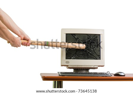 Breaking in a monitor with a baseball bat, isolated on white. - stock photo