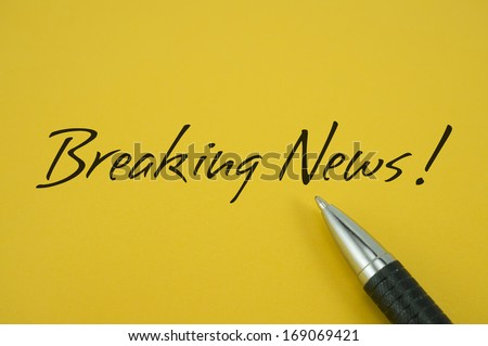 Breaking News note with pen on yellow background - stock photo