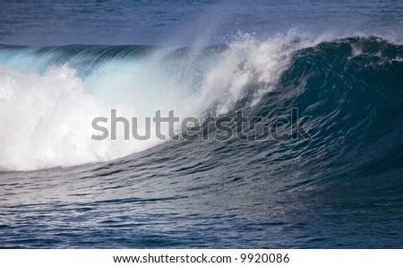 Breaking ocean wave spotted at Puerto de la Cruz, Tenerife, Canary Islands - stock photo