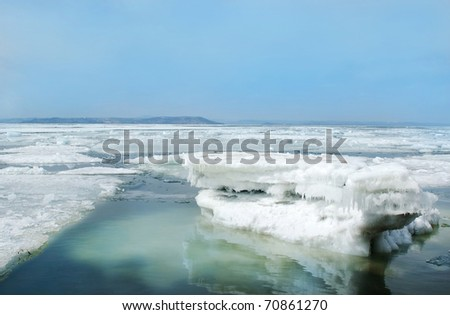 breaking spring floating ice - stock photo