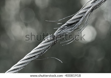 Breaking steel cable - stock photo