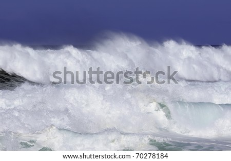 Breaking surf almost obliterates horizon of Pacific Ocean along North Shore of Oahu - stock photo
