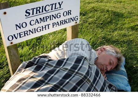 breaking the rules and sleeping rough - stock photo