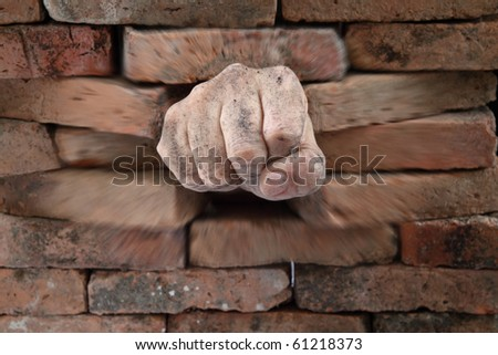 breaking the wall - stock photo