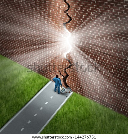 Breaking the wall business concept with a businessman using a sledge hammer to break through a huge brick obstacle creating a glowing crack showing hope and opportunity through confident leadership. - stock photo