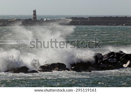 Breaking wave splash and spray. Focus on the wave. Povoa de Varzim harbor, Portugal.