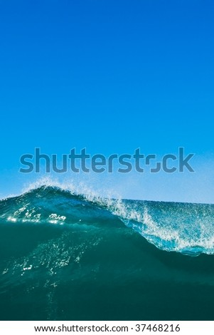 Breaking Wave with Clear Blue Sky, Room for Text and Copy Space - stock photo