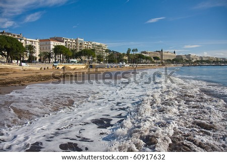 Breaking waves at the beach of Cannes, France - stock photo