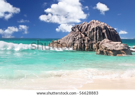 Breaking Waves on Boulders on The Island of La Dique in The Seychelles - stock photo
