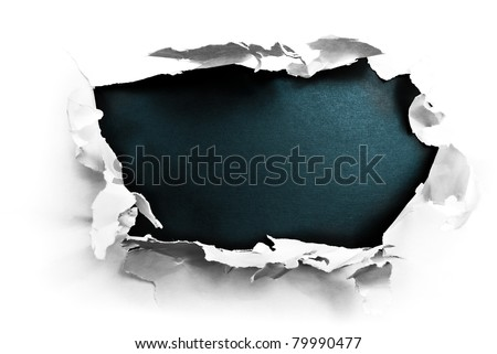 Breakthrough paper hole with black textured background. - stock photo