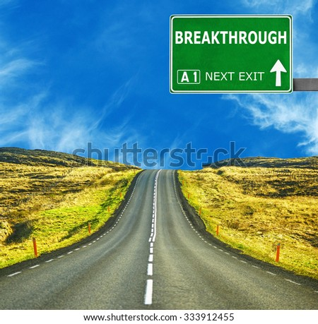 BREAKTHROUGH  road sign against clear blue sky - stock photo
