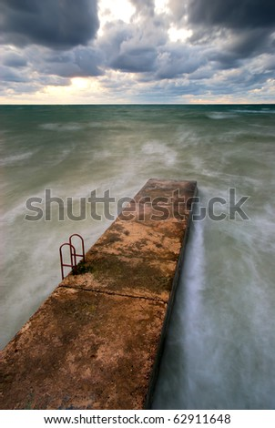 Breakwater in sea. Nature composition. - stock photo
