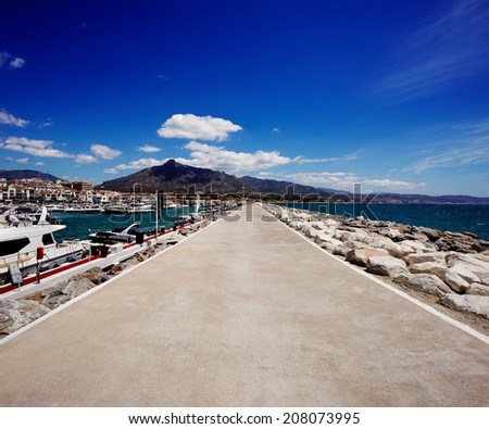 Breakwater in the Puerto Banus in Marbella, Spain. Marbella is a popular holiday destination located on the Costa del Sol in the southern Andalusia - stock photo