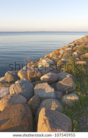 Breakwater in the sunset at summer time. Copy space