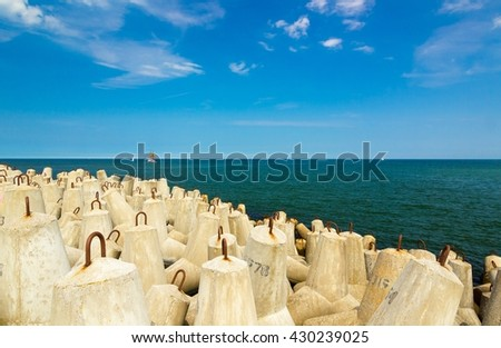 breakwater on the Baltic sea, ship in the distance - stock photo