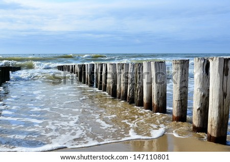 breakwaters in waves on  the beach at the north sea in Domburg Holland - stock photo