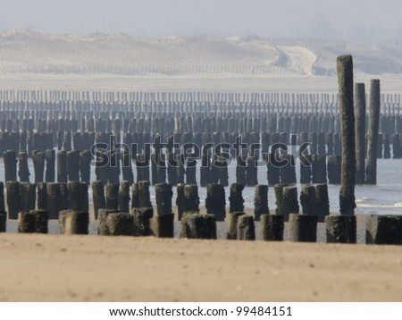 breakwaters on the beach of Groede in the Netherlands - stock photo