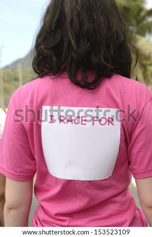 Breast cancer awareness event: woman with sticker - stock photo