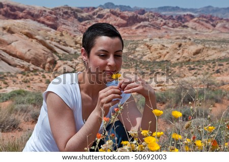Breast cancer patient enjoying life again after chemo treatment ( wild flowers in the desert) - stock photo