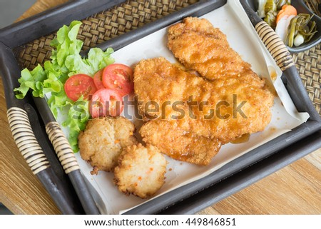 Breast chicken fried with fried rice sushi. - stock photo