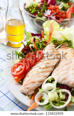 Breast of chicken with fresh salad - stock photo