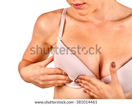 Breast self exam. Girl examines her breasts. Medicine concept. - stock photo