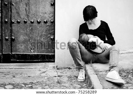 Breastfeeding in the street - stock photo