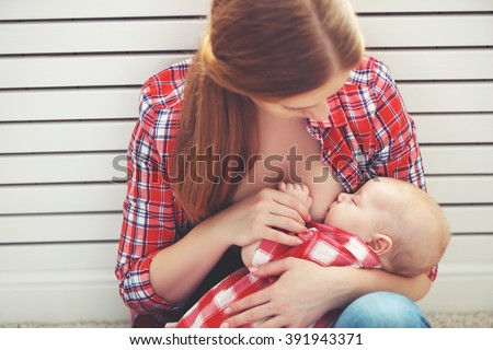 breastfeeding. mother breast feeding her baby toddler - stock photo