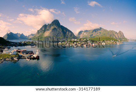 Breathtaking aerial panorama of fishing town Reine and surrounding fjords on Lofoten islands in Norway, famous tourist destination - stock photo