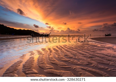 Breathtaking sunset at Kamala beach - stock photo