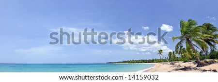 Breathtaking tropical beach panorama with a lot of copy-space, ideal for summer travel themes - stock photo