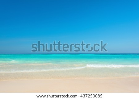 Breathtaking turquoise sea, Exotic beach with gentle wave and clear, Ripple wave and clear on beac with blue sky - stock photo