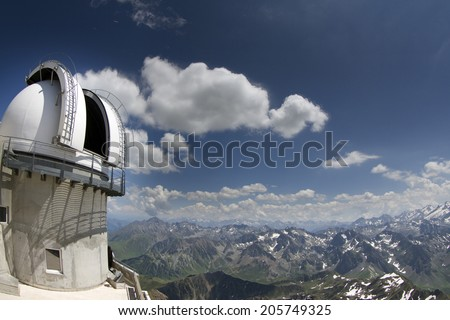 breathtaking view of pyrenees from pic du midi in france with observatory tower - stock photo