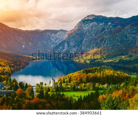 Breathtaking view of the famous Bohinj lake from above. Beautiful view ot the Triglav mountains, Triglav national park, and the church of St John the Baptist,.Slovenia, Europe - stock photo