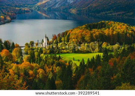 Breathtaking view of the famous Bohinj lake from above. Beautiful view ot the Triglav mountains, Triglav national park, and the church of St John the Baptist,.Slovenia, Europe