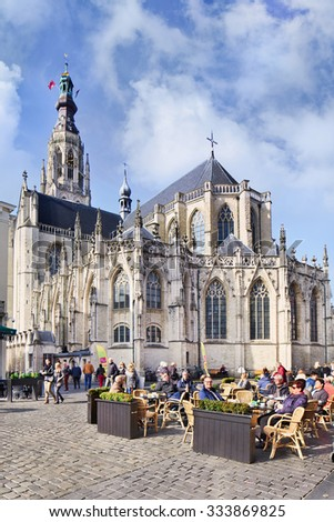BREDA-HOLLAND-OCT. 10, 2015. The Grote Kerk or Onze-Lieve-Vrouwekerk (Church of Our Lady) is the major monument and landmark of Breda, built in Brabantine Gothic style. The tower is 97 meters tall.  - stock photo