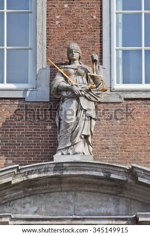 BREDA-HOLLAND-OCTOBER 10, 2015. Lady Justice, goddess of Justice. Her blindfold represents objectivity, the balance in her left hand weighing of evidence and the sword in her right hand punishment.  - stock photo