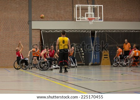 BREDA, NETHERLANDS - OCTOBER 12 : Dutch physically disabled athletes playing wheelchair basketball during the Paragames, a big bi-yearly event on OCTOBER 12, 2013 in BREDA, NETHERLANDS - stock photo