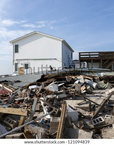 BREEZY POINT, NY - DECEMBER 3: After more than a month from Hurricane Sandy no major reconstruction work began on Oceanside Drive at Breezy Point, New York, U.S., on Monday, December 03, 2012. - stock photo