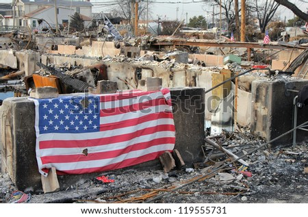 BREEZY POINT, NY - NOVEMBER 20: Burned house in the aftermath of Hurricane Sandy on November 20, 2012 in Breezy Point, NY. More than 80 houses were destroyed in out-of-control six-alarm blaze. - stock photo