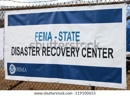 BREEZY POINT, NY - NOVEMBER 15: FEMA opens disaster recovery center  in devastated area in the aftermath of Hurricane Sandy on November 15, 2012 in Breezy Point, NY - stock photo